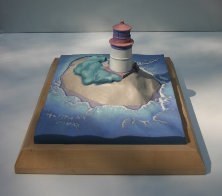 Sculpture: Lighthouse on small sand island surrounded by water