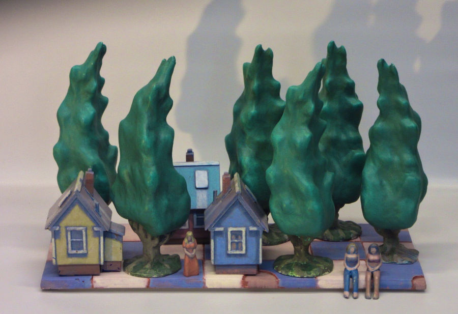 sculpture of trees, houses and women on a checkerboard pattern