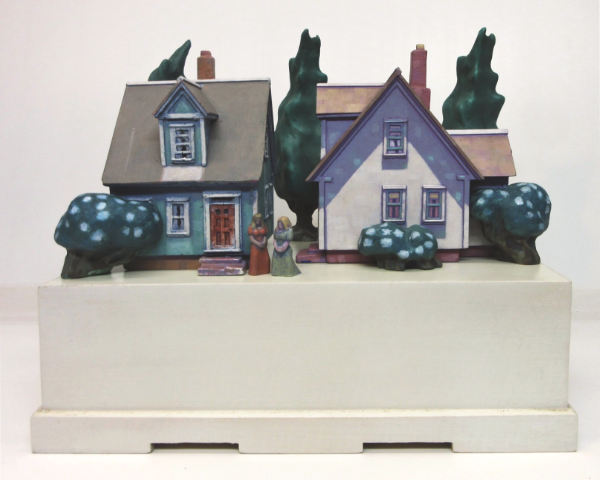 sculpture of houses, trees and women